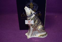 A Royal Crown Derby paperweight Wolf, boxed with a gold stopper