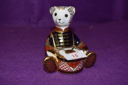 A Royal Crown Derby paperweight Drummer Bear with a Gold stopper