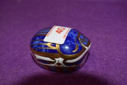 A Royal Crown Derby paperweight Millenium Bug with gold stopper