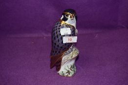A Royal Crown Derby paperweight Peregrine Falcon with a Gold stopper