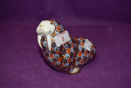 A Royal Crown Derby paperweight Walrus with a Silver stopper
