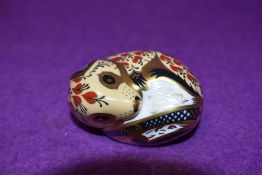 A Royal Crown Derby paperweight Sleeping Dormouse, with silver stopper
