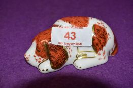 A Royal Crown Derby paperweights Puppy, with gold stoppers