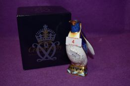 A Royal Crown Derby paperweight Emperor Penguin boxed and with a Gold stopper