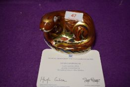 A Royal Crown Derby paperweight Otter with gold stopper and certificate