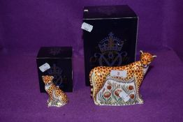 Two Royal Crown Derby paperweights. Leopardess and Leopard Cub, both boxed and with gold stoppers