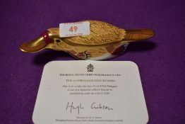 A Royal Crown Derby paperweight Duck Billed Platypus with gold stopper and certificate