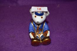 A Royal Crown Derby paperweight Schoolboy Teddy with a Gold stopper