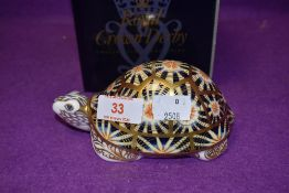 A Royal Crown Derby paperweight Indian Star Tortoise, boxed with a gold stopper