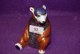 A Royal Crown Derby paperweight Honey Bear with gold stopper