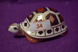 A Royal Crown Derby paperweight Imari Tortoise, with silver stopper