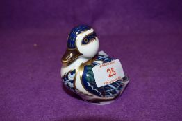A Royal Crown Derby paperweight Sitting Duck with gold stopper