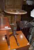 A traditional mahogany wine table on triple splay legs , diameter approx. 31cm