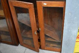 A traditional stained frame bookcase top