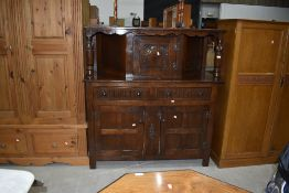 An early to mid 20th Century reproduction oak court cupboard, width approx. 125cm