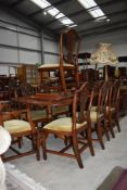 A reproduction Regency extending dining table and eight (six plus two) chairs