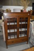 An early 20th Century mahogany display cabinet with lower drawer, dimensions approx. Width 99cm