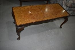 An early to mid 20th Century walnut coffee table having cabriole legs, approx. 107 x 46cm