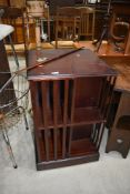 A reproduction mahogany effect revolving bookcase
