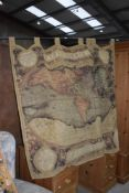 A reproduction tapestry wall hanging depicting world map, with hanger, width approx. 210cm