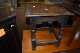 A period oak coffin type stool, approx. 40 x 32cm, old damage adds to the character of the piece