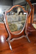 A traditional mahogany dressing table mirror, shield form, width approx. 37cm