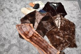 An assortment of vintage gloves and mittens and scarves including fur stoles,one being mink.