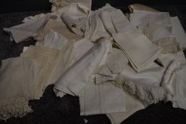 A collection of white work table linen, with various techniques and fabrics used.
