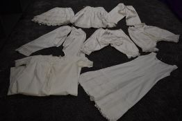 A collection of victorian white cotton items including two pairs of Victorian bloomers, crisp cotton