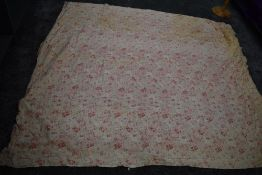 An early 20th century floral cotton bed throw,cotton wool filled, some age related wear.