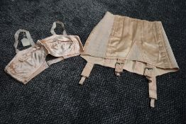 A pale pink CC41 girdle and bra,bra still having original price attached,smaller sizes.