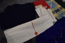 A mixed lot of vintage fabrics, perfect for crafts and projects.
