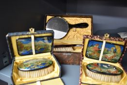 Two pretty vintage brush and mirror sets in boxes having Dutch scenes or similar, with transfers