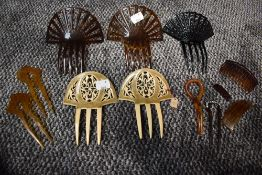 A variety of art deco hair combs and slides.