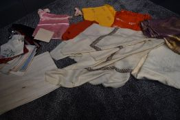 A mixture of vintage and antique shawls,handkerchiefs, fabrics and more.