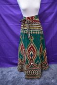 A bright vintage wrap around skirt from Burma and similar styled tunic