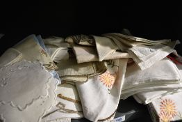A selection of vintage and antique table linen.