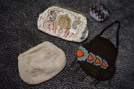 Three extensively beaded antique bags and a coin purse.
