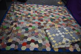 Two retro patchwork quilts, having vibrant floral fabrics used throughout.
