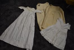 A small lot of early 20th century items,Two childrens wool petticoats or undergarments,a dress