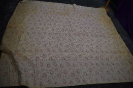 An early 20th century paisley cotton bed throw,cotton wool filled, some age related wear/staining.