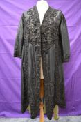 A Victorian opera coat having mint green lining and ornate frogging and cord detailing throughout '