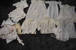 A varied lot of childrens/babies clothing, some knitted, others cotton with delicate detailing,