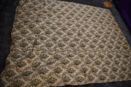 A vintage bed throw, floral to one side and pink and wool woven fabric to reverse.