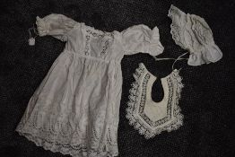 An antique chidrens gown with deep hem of cut work and embroidery ,drawstrings to cuffs and back,a