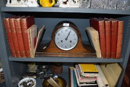An oak cased mantle clock of Napoleon design and Book of knowledge and printing text books
