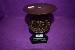 A small set of salter scales having brass face and wooden body.