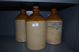 Three earthenware advertising bottles, of Bolton,Accrington, Blackpool and similar areas.