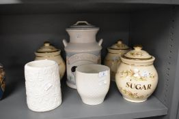 A collection of ceramics including kitchen jars and more.