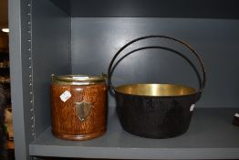 An oak biscuit barrel and brass jam pan